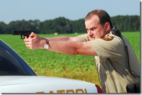 Alex Kendrick as Adam Mitchell in ``Courageous.''